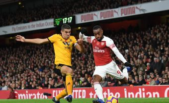 LONDON, ENGLAND - NOVEMBER 11:  Alexandre Lacazette of Arsenal crosses under pressure from Connor Coady of Wolves during the Premier League match between Arsenal FC and Wolverhampton Wanderers at Emirates Stadium on November 11, 2018 in London, United Kingdom.  (Photo by David Price/Arsenal FC via Getty Images) *** Local Caption *** Alexandre Lacazette; Connor Coady