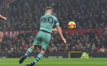 MANCHESTER, ENGLAND - DECEMBER 05:  Shkodran Mustafi scores Arsenal's goal during the Premier League match between Manchester United and Arsenal FC at Old Trafford on December 5, 2018 in Manchester, United Kingdom.  (Photo by David Price/Arsenal FC via Getty Images) *** Local Caption *** Shkodran Mustafi