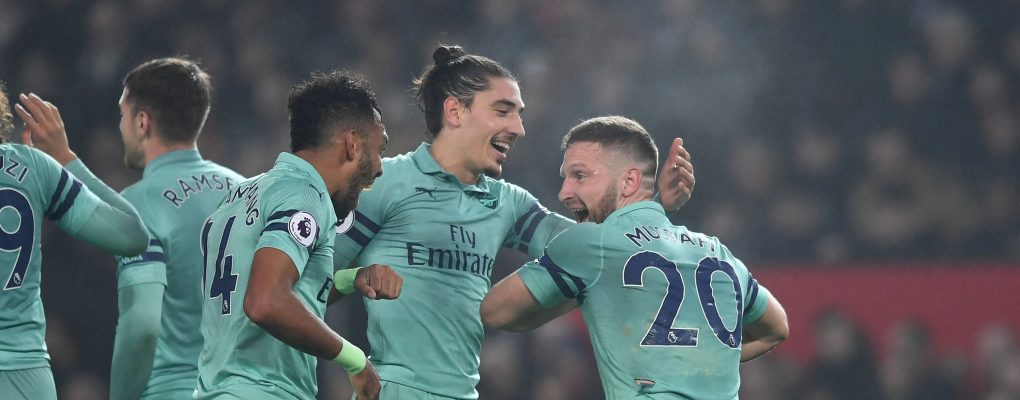 MANCHESTER, ENGLAND - DECEMBER 05:  Shkodran Mustafi celebrates scoring Arsenal's 1st goal with Pierre-Emerick Aubameyang and Hector Bellerin during the Premier League match between Manchester United and Arsenal FC at Old Trafford on December 5, 2018 in Manchester, United Kingdom.  (Photo by David Price/Arsenal FC via Getty Images) *** Local Caption *** Shkodran Mustafi; Pierre-Emerick Aubameyang; Hector Bellerin