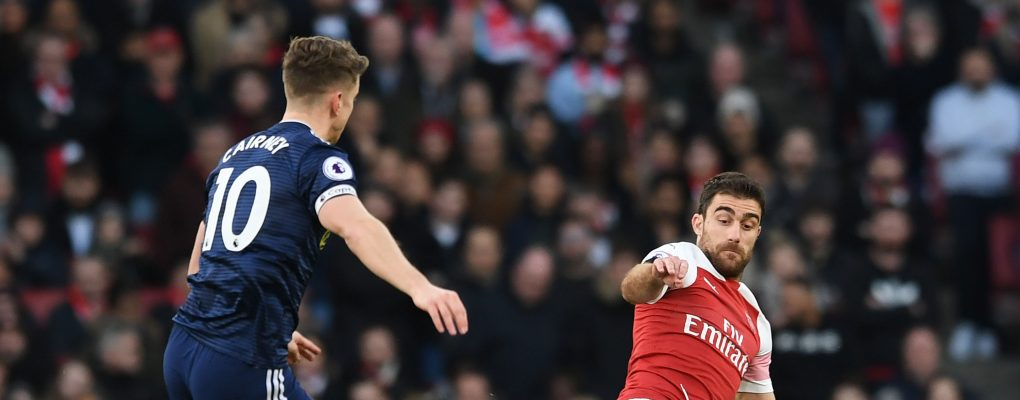 LONDON, ENGLAND - JANUARY 01:  Sokratis of Arsenal clears the ball under pressure from Tom Cairney of Fulham during the Premier League match between Arsenal FC and Fulham FC at Emirates Stadium on January 1, 2019 in London, United Kingdom.  (Photo by David Price/Arsenal FC via Getty Images) *** Local Caption *** Tom Cairney; Sokratis