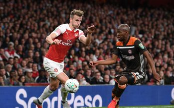 LONDON, ENGLAND - SEPTEMBER 26:  Rob Holding of Arsenal takes on Moses Odubajo of Brentford during the Carabao Cup Third Round match between Arsenal and Brentford at Emirates Stadium on September 26, 2018 in London, England.  (Photo by David Price/Arsenal FC via Getty Images) *** Local Caption *** Rob Holding; Moses Odubajo