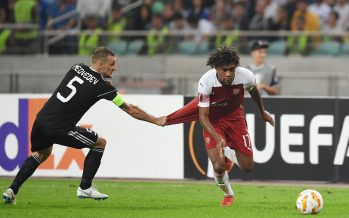 BAKU, AZERBAIJAN - OCTOBER 04:  Alex Iwobi of Arsenal held back by Maksim Medvedev of Qarabag during the UEFA Europa League Group E match between Qarabag FK and Arsenal at  on April 10, 2018 in Baku, Azerbaijan.  (Photo by Stuart MacFarlane/Arsenal FC via Getty Images) *** Local Caption *** Alex Iwobi;Maksim Medvedev