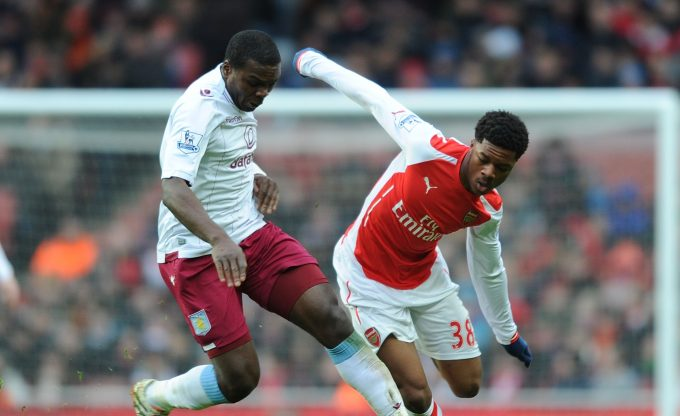 LONDON, ENGLAND - FEBRUARY 01:  Chuba Akpom of Arsenal challenged by Jores Okire of Aston Villa during the Barclays Premier League match between Arsenal and Aston Villa at Emirates Stadium on February 1, 2015 in London, England.  (Photo by Stuart MacFarlane/Arsenal FC via Getty Images) *** Local Caption *** Chuba Akpom;Jores Okore