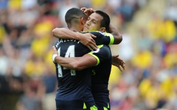 WATFORD, ENGLAND - AUGUST 27: (R) Alexis Sanchez celebrates scoring the 2nd Arsenal goal with (L) Theo Walcott during the Premier League match between Watford and Arsenal at Vicarage Road on August 27, 2016 in Watford, England. (Photo by Stuart MacFarlane/Arsenal FC via Getty Images) *** Local Caption *** Alexis Sanchez;Theo Walcott