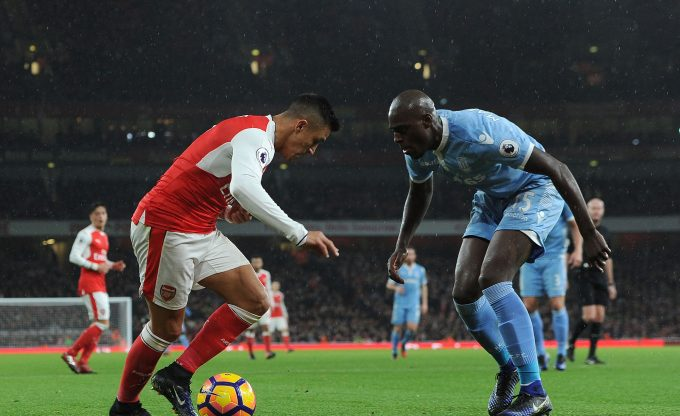 LONDON, ENGLAND - DECEMBER 10:  Alexis Sanchez of Arsenal takes on Bruno Martins Indi of Stoke during the Premier League match between Arsenal and Stoke City at Emirates Stadium on December 10, 2016 in London, England.  (Photo by David Price/Arsenal FC via Getty Images) *** Local Caption *** Alexis Sanchez; Bruno Martins Indi
