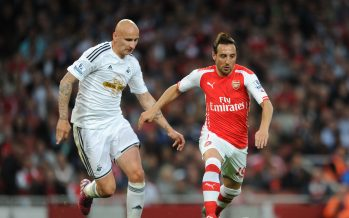 LONDON, ENGLAND - MAY 11:  Santi Cazorla of Arsenal takes on Jonjo Shelvey of Swansea during the match between Arsenal and Swansea City in the Barclays Premier League at Emirates Stadium on May 11, 2015 in London, England.  (Photo by David Price/Arsenal FC via Getty Images) *** Local Caption *** Santi Cazorla; Jonjo Shelvey