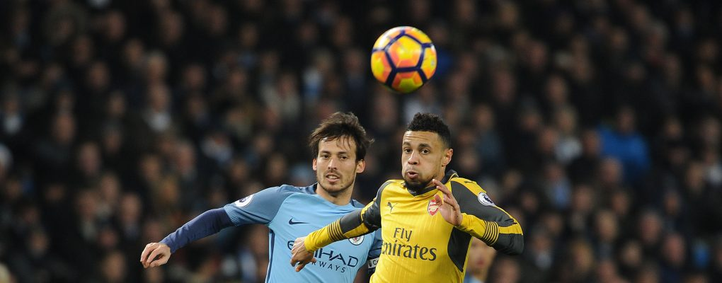 MANCHESTER, ENGLAND - DECEMBER 18:  Francis Coquelin of Arsenal holds off David Silva of Man City during the Premier League match between Manchester City and Arsenal at Etihad Stadium on December 18, 2016 in Manchester, England.  (Photo by Stuart MacFarlane/Arsenal FC via Getty Images) *** Local Caption *** Francis Coquelin;David Silva
