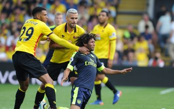 WATFORD, ENGLAND - AUGUST 27:  Mohamed Elneny of Arsenal pulled back by Watford's Etienne Capoue during the Premier League match between Watford and Arsenal at Vicarage Road on August 27, 2016 in Watford, England.  (Photo by Stuart MacFarlane/Arsenal FC via Getty Images) *** Local Caption *** Mohamed Elneny;Etienne Capoue