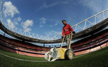 LONDON, ENGLAND - MARCH 07:  Arsenal groundsman Reece Watson marks out the Emirates pitch ahead of the UEFA Champions League Round of 16 second leg match between Arsenal FC and FC Bayern Muenchen at Emirates Stadium on March 7, 2017 in London, United Kingdom.  (Photo by David Price/Arsenal FC via Getty Images) *** Local Caption *** Arsenal Groundsman marking out
