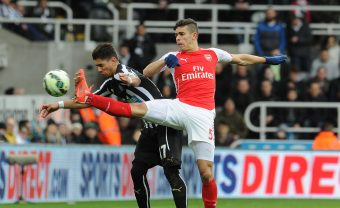 NEWCASTLE UPON TYNE, ENGLAND - MARCH 21:  Gabriel of Arsenal challenges Ayoze Perez of Newcastle during the match between Newcastle United and Arsenal in the Barclays Premier League at St James' Park on March 21, 2015 in Newcastle upon Tyne, England.  (Photo by David Price/Arsenal FC via Getty Images) *** Local Caption *** Gabriel; Ayoze Perez