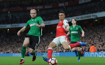 LONDON, ENGLAND - MARCH 11:  Kieran Gibbs of Arsenal takes on Bradley Wood of Lincoln during the match between Arsenal and Lincoln City at Emirates Stadium on March 11, 2017 in London, England.  (Photo by David Price/Arsenal FC via Getty Images) *** Local Caption *** Kieran Gibbs; Bardley Wood