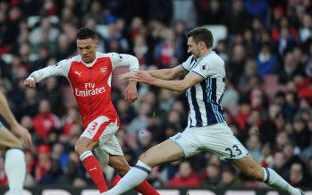 LONDON, ENGLAND - DECEMBER 26: Kieran Gibbs of Arsenal takes on Gareth McAuley of WBA during the Premier League match between Arsenal and West Bromwich Albion at Emirates Stadium on December 26, 2016 in London, England. (Photo by Stuart MacFarlane/Arsenal FC via Getty Images) *** Local Caption *** Kieran Gibbs;Gareth McAuley