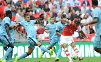 LONDON, ENGLAND - AUGUST 10:  Olivier Giroud scores Arsenal's 3rd goal under pressure from Matija Nastasic of Manchester City during the Community Shield match between Arsenal and Mancheser City at Wembley Stadium on August 10, 2014 in London, England.  (Photo by David Price/Arsenal FC via Getty Images) *** Local Caption *** Olivier Giroud; Matija Nastasic