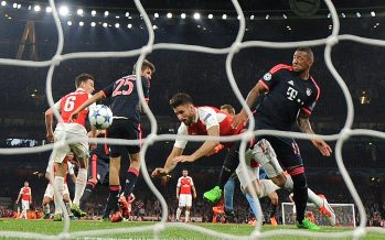 LONDON, ENGLAND - OCTOBER 20:  Olivier Giroud scores Arsenal's 1st goal under pressure from Jerome Boateng of Bayern during the UEFA Champions League match between Arsenal and Bayern Munich on October 20, 2015 in London, United Kingdom.  (Photo by David Price/Arsenal FC via Getty Images) *** Local Caption *** Olivier Giroud; Jerome Boateng