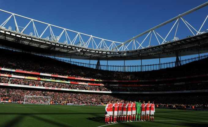 LONDON, ENGLAND - NOVEMBER 06:  The Arsenal team line up to observe a moment of silence for  Rememberance Day before the Premier League match between Arsenal and Tottenham Hotspur at Emirates Stadium on November 6, 2016 in London, England.  (Photo by Stuart MacFarlane/Arsenal FC via Getty Images)