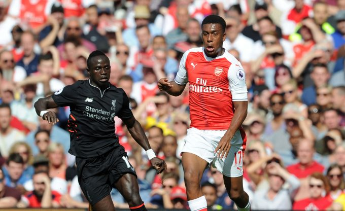 LONDON, ENGLAND - AUGUST 14: Alex Iwobi of Arsenal breaks past Sadio Mane of Liverpool during the Premier League match between Arsenal and Liverpool at Emirates Stadium on August 14, 2016 in London, England. (Photo by Stuart MacFarlane/Arsenal FC via Getty Images) *** Local Caption *** Alex Iwobi;Sadio Mane