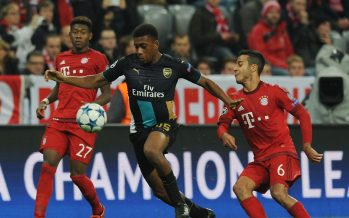 MUNICH, GERMANY - NOVEMBER 04: Alex Iwobi of Arsenal breaks past Thiago of Bayern Munich during the UEFA Champions League Group Stage match between Bayern Muenchen and Arsenal at the Allianz Arena on November 4, 2015 in Munich, Germany. (Photo by Stuart MacFarlane/Arsenal FC via Getty Images *** Local Caption *** Alex Iwobi;Thiago