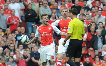 LONDON, ENGLAND - SEPTEMBER 13:  Jack Wilshere of Arsenal shouts at Referee Mark Clattenburg during the Barclays Premier League match between Arsenal and Manchester City at Emirates Stadium on September 13, 2014 in London, England.  (Photo by David Price/Arsenal FC via Getty Images) *** Local Caption *** Jack Wilshere