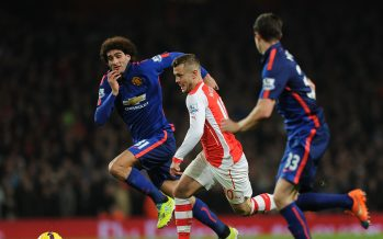 LONDON, ENGLAND - NOVEMBER 22: Jack Wilshere of Arsenal breaks past Marouane Fellaini and Paddy McNair of Manchester United during the Barclays Premier League match between Arsenal and Manchester United at Emirates Stadium on November 22, 2014 in London, England. Photo by Stuart MacFarlane/Arsenal FC via Getty Images)  *** Local Caption *** Jack Wilshere;Marouane Fellaini;Paddy McNair
