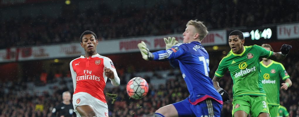 LONDON, ENGLAND - JANUARY 09:  Jeff Reine-Adelaide of Arsenal is closed down by Jordan Pickford of Sunderland during the match between Arsenal and Sunderland in the FA Cup 3rd Round at Emirates Stadium on January 9, 2016 in London, England.  (Photo by David Price/Arsenal FC via Getty Images) *** Local Caption *** Jeff Reine-Adelaide; Jordan Pickford