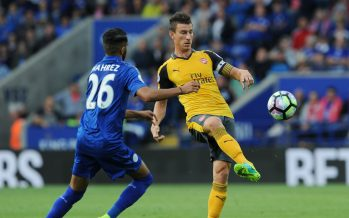 LEICESTER, ENGLAND - AUGUST 20:  Alex Oxlade-Chamberlain of Arsenal takes on Riyad Mahrez of Leicester during the Premier League match between Leicester City and Arsenal at The King Power Stadium on August 20, 2016 in Leicester, England.  (Photo by Stuart MacFarlane/Arsenal FC via Getty Images) *** Local Caption *** Laurent Koscielny;Riyad Mahrez