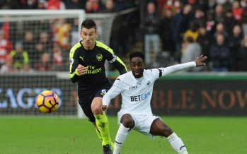 SWANSEA, WALES - JANUARY 14: Laurent Koscielny of Arsenal challenges Nathan Dyer of Swansea during the Premier League match between Swansea City and Arsenal at Liberty Stadium on January 14, 2017 in Swansea, Wales.  (Photo by David Price/Arsenal FC via Getty Images) *** Local Caption *** Laurent Koscielny; Nathan Dyer