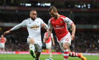 LONDON, ENGLAND - MAY 11: Jack Wilshere of Arsenal takes in Ashley Richards of Swansea during the Barclays Premier League match between Arsenal and Swansea City at Emirates Stadium on May 11, 2015 in London, England. (Photo by Stuart MacFarlane/Arsenal FC via Getty Images) *** Local Caption *** Jack Wilshere;Ashley Richards
