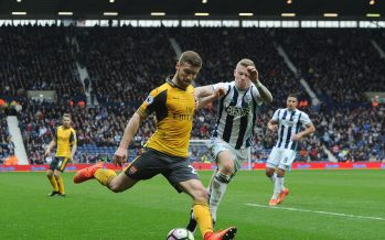 WEST BROMWICH, ENGLAND - MARCH 18:  Shkodran Mustafi of Arsenal crosses the ball under pressure from James McClean of WBA during the Premier League match between West Bromwich Albion and Arsenal at The Hawthorns on March 18, 2017 in West Bromwich, England.  (Photo by David Price/Arsenal FC via Getty Images) *** Local Caption *** Shkodran Mustafi; James McClean