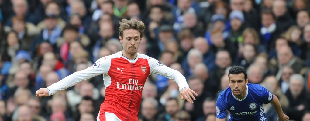 LONDON, ENGLAND - FEBRUARY 04: Nacho Monreal of Arsenal breaks past Pedro of Chelsea during the Premier League match between Chelsea and Arsenal at Stamford Bridge on February 4, 2017 in London, England. (Photo by Stuart MacFarlane/Arsenal FC via Getty Images) *** Local Caption *** Nacho Monreal;Pedro