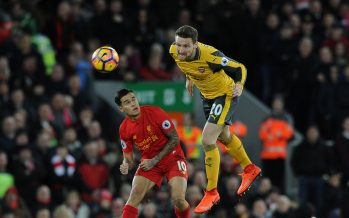 LIVERPOOL, ENGLAND - MARCH 04:  Shkodran Mustafi of Arsenal heads the ball away from Philippe Coutinho of Liverpool during the Premier League match between Liverpool and Arsenal at Anfield on March 4, 2017 in Liverpool, England.  (Photo by David Price/Arsenal FC via Getty Images) *** Local Caption *** Shkodran Mustafi; Philippe Coutinho