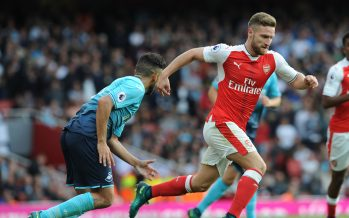 LONDON, ENGLAND - OCTOBER 15:  Shkodran Mustafi of Arsenal takes on Neil Taylor of Swansea during the Premier League match between Arsenal and Swansea City at Emirates Stadium on October 15, 2016 in London, England.  (Photo by David Price/Arsenal FC via Getty Images) *** Local Caption *** Shkodran Mustafi; Neil Taylor
