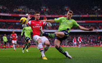 Nathan Baker of Villa in action with Carl Jenkinson of Arsenal