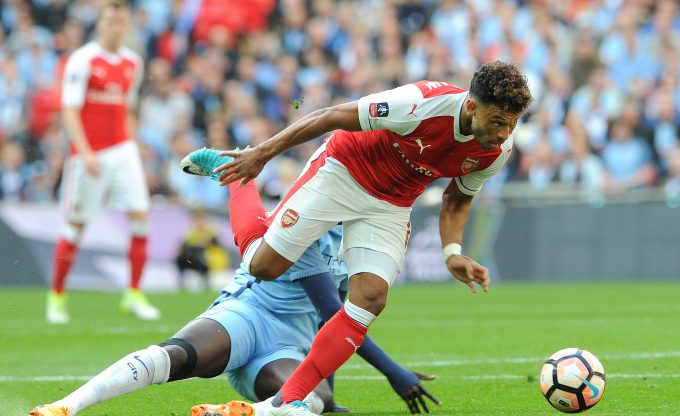 LONDON, ENGLAND - APRIL 23:  Alex Oxlade-Chamberlain of Arsenal takes on Yaya Toure of Manchester City during the match between Arsenal and Manchester City at Wembley Stadium on April 23, 2017 in London, England.  (Photo by David Price/Arsenal FC via Getty Images) *** Local Caption *** Alex Oxlade-Chamberlain; Yaya Toure