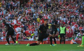 LONDON, ENGLAND - AUGUST 14:  Alex Oxlade-Chamberlain scores Arsenal's 2nd goal past Dejan Lovren of Liverpool during the Premier League match between Arsenal and Liverpool at Emirates Stadium on August 14, 2016 in London, England.  (Photo by David Price/Arsenal FC via Getty Images) *** Local Caption *** Alex Oxlade-Chamberlain; Dejan Lovren