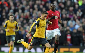 MANCHESTER, ENGLAND - NOVEMBER 19:  Mesut Ozil of Arsenal breaks past Paul Pogba of Man United during the Premier League match between Manchester United and Arsenal at Old Trafford on November 19, 2016 in Manchester, England.  (Photo by Stuart MacFarlane/Arsenal FC via Getty Images) *** Local Caption *** Mesut Ozil;Oezil;Paul Pogba