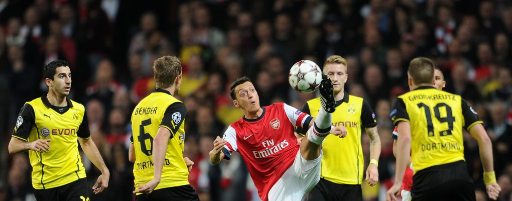 LONDON, ENGLAND - OCTOBER 22:  Mesut Ozil of Arsenal controls the ball under pressure from Sven bender and Henrikh Mkhitaryan of Borussia the match between Arsenal and Borussia Dortmund at Emirates Stadium on October 22, 2013 in London, England.  (Photo by David Price/Arsenal FC via Getty Images) *** Local Caption *** Mesut Ozil; Oezil; Sven Bender; Hanrikh Mkhitaryan