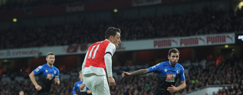 LONDON, ENGLAND - DECEMBER 28:  Mesut Ozil scores Arsenal's 2nd goal during the Barclays Premier League match between Arsenal and Bournemouth at Emirates Stadium on December 28, 2015 in London, England.  (Photo by David Price/Arsenal FC via Getty Images) *** Local Caption *** Mesut Ozil; Oezil