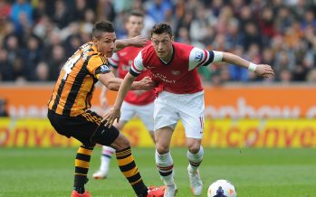 HULL, ENGLAND - APRIL 20: Mesut Ozil of Arsenal breraks past Jake Livermore of Hull during the Barclays Premier League match between Hull City and Arsenal at the KC Stadium on April 20, 2014 in Hull, England. (Photo by Stuart MacFarlane/Arsenal FC via Getty Images)  *** Local Caption *** Mesut Ozil;Oezil;Jake Livermore