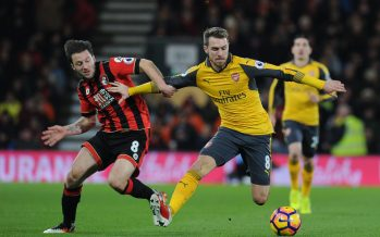 BOURNEMOUTH, ENGLAND - JANUARY 03:  Aaron Ramsey of Arsenal takes on Harry Arter of Bournemouth during the Premier League match between AFC Bournemouth and Arsenal at Vitality Stadium on January 3, 2017 in Bournemouth, England.  (Photo by Stuart MacFarlane/Arsenal FC via Getty Images) *** Local Caption *** Aaron Ramsey;Harry Arter