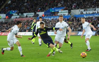 SWANSEA, WALES - JANUARY 14:  Aaron Ramsey of Arsenal shoots under pressure from Alfie Mawson of Swansea during the Premier League match between Swansea City and Arsenal at Liberty Stadium on January 14, 2017 in Swansea, Wales.  (Photo by David Price/Arsenal FC via Getty Images) *** Local Caption *** Aaron Ramsey; Alfie Mawson