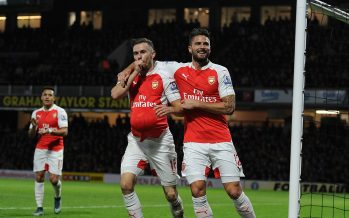 WATFORD, ENGLAND - OCTOBER 17:  (L) Aaron Ramsey celebrates soring the 3rd Arsenal goal with (R) Olivier Giroud during the Barclays Premier League match between Watford and Arsenal at Vicarage Road on October 17, 2015 in Watford, England.  (Photo by Stuart MacFarlane/Arsenal FC via Getty Images) *** Local Caption *** Aaron Ramsey;Olivier Giroud