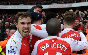 LONDON, ENGLAND - FEBRUARY 14:  Aaron Ramsey celebrates the 2nd Arsenal goal with fans during the Barclays Premier League match between Arsenal and Leicester City at Emirates Stadium on February 14th, 2016 in London, England  (Photo by David Price/Arsenal FC via Getty Images) *** Local Caption *** Aaron Ramsey