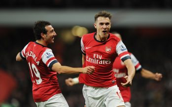 LONDON, ENGLAND - NOVEMBER 02: (R) Aaron Ramsey celebrates scoring the 2nd Arsenal goal with (L) Santi Cazorla during the Barclays Premier League match between Arsenal and Liverpool at Emirates Stadium on November 02, 2013 in London, England. (Photo by Stuart MacFarlane/Arsenal FC via Getty Images) *** Local Caption *** Aaron Ramsey;Santi Cazorla