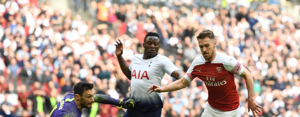 LONDON, ENGLAND - MARCH 02: Aaron Ramsey takes the ball around Hugo Lloris to score for Arsenal during the Premier League match between Tottenham Hotspur and Arsenal FC at Wembley Stadium on March 02, 2019 in London, United Kingdom. (Photo by Stuart MacFarlane/Arsenal FC via Getty Images)