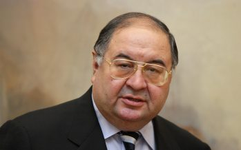 LONDON - NOVEMBER 07:  Russian Oligarch Alisher Usmanov is pictured in front of JMW Turner's painting ' The Harbour of Brest ' in the Tate Britain art gallery on November 7, 2008 in London, England. The Pushkin Museum in Moscow is hosting a major exhibition of works by JMW Turner on loan from Tate Britain thanks to it's sole sponsor, Alisher Usmanov. Mr Usmanov who is a major shareholder in the Russian industrial conglomerate, Metalloinvest, as well as Arsenal Football Club, is reported to have a personal fortune of approximately £2.7bn.    (Photo by Oli Scarff/Getty Images)
