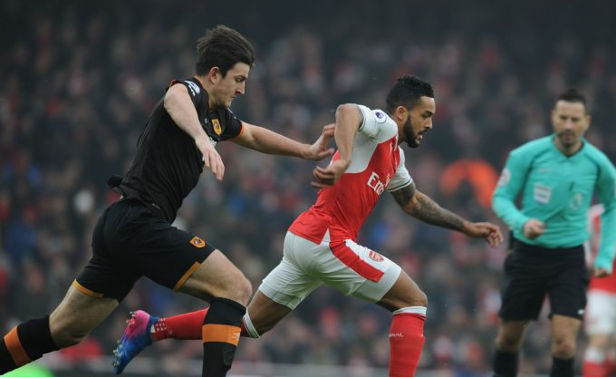 LONDON, ENGLAND - FEBRUARY 11: Theo Walcott of Arsenal breaks past Harry Maguire of Hull during the Premier League match between Arsenal and Hull City at Emirates Stadium on February 11, 2017 in London, England. (Photo by Stuart MacFarlane/Arsenal FC via Getty Images) *** Local Caption *** Theo Walcott;Harry Maguire