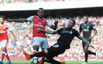 LONDON, ENGLAND - AUGUST 14:  Theo Walcott of Arsenal tripped by Liverpool defender Alberto Moreno during the Premier League match between Arsenal and Liverpool at Emirates Stadium on August 14, 2016 in London, England.  (Photo by Stuart MacFarlane/Arsenal FC via Getty Images) *** Local Caption *** Theo Walcott;Alberto Moreno