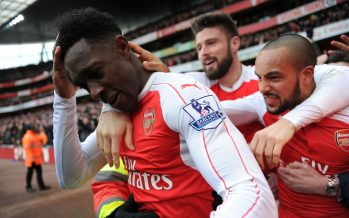LONDON, ENGLAND - FEBRUARY 14:  Danny Welbeck celebrates scoring Arsenal's 2nd goal with Theo Walcott and Olivier Giroud and the fans during the Barclays Premier League match between Arsenal and Leicester City at Emirates Stadium on February 14th, 2016 in London, England  (Photo by David Price/Arsenal FC via Getty Images) *** Local Caption *** Danny Welbeck; Theo Walcott; Olivier Welbeck