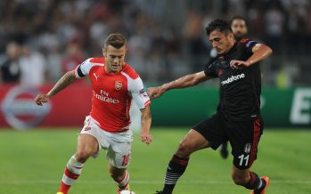 ISTANBUL, TURKEY - AUGUST 19: Jack Wilshere of Arsenal takes on Mustafa Pektemek of Besiktas during the match between Besiktas and Arsenal in the UEFA Champions League Qualifier 1st leg on August 19, 2014 in Istanbul, Turkey.  (Photo by David Price/Arsenal FC via Getty Images) *** Local Caption *** Jack Wilshere; Mustafa Pektemek